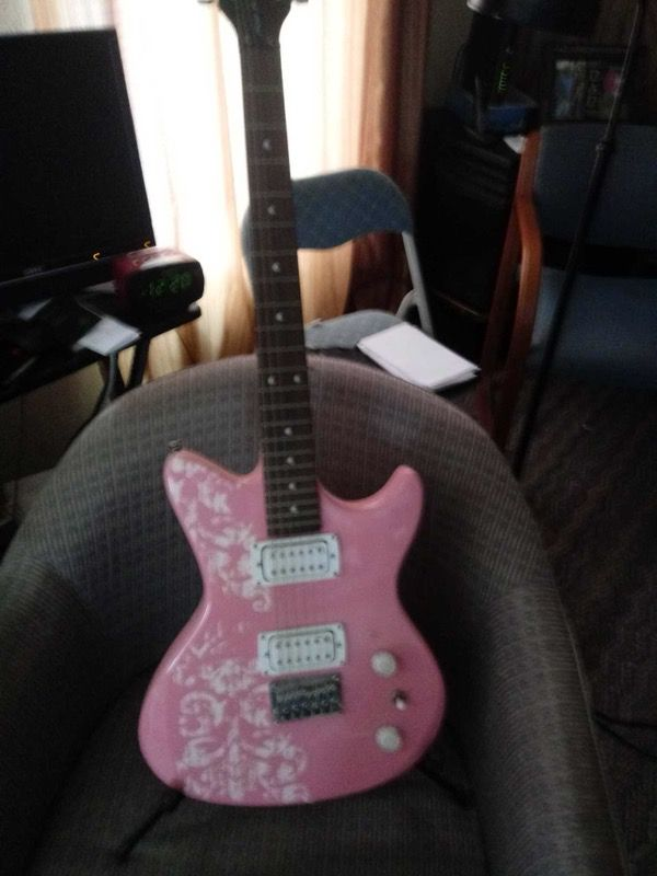 Pink Electric Guitar Comes With Stand And Small Amp