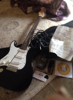 Aria Electric guitar with cloth case,tuner,cord ,pic,and lessons