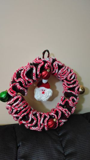 Handmade crochet wreath with santa