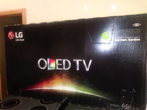 """NEW OPEN BOX 65""""OLED TV AMONG THE TOP TV AVAILABLE NEED MR600 REMOTE HAVE TINY HAIR LINE"""