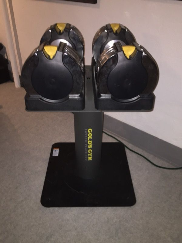 Golds Gym switch plate adjustable dumbbells with metal stand. In excellent condition. Each dumbbell adjustable from 10lbs to 50lbs in 5lb increments.