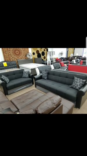 Brand new black color sofa loveseat living room set that converts into beds