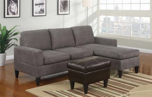 Brand new gray microfiber sectional with leather ottoman