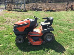 Husqvarna- 42 inch cut. Needs a battery. We used it last summer but purchased a zero cut mover so don't need it anymore.