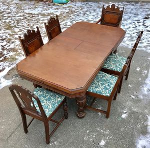 Stunning Jacobean solid wood dining table and 6 chairs