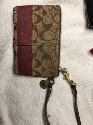 Coach tan and red wristlet some wear