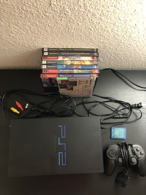 PlayStation 2 console w/ controller, memory card, cables, 9 games