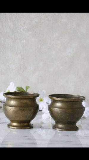 two pure brass containers
