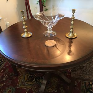 Ashley dining table and two chairs and 5 year warranty
