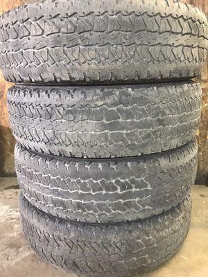 Four 235-75-R17 tires