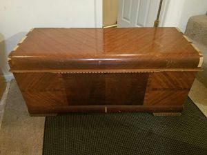 Vintage wooden storage chest with shelf