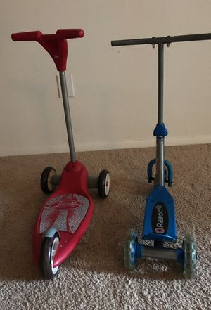 Radio flyer in red and Razor scooters in blue for sale