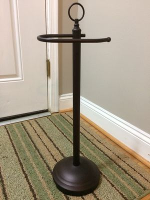 Rubbed bronze toilet paper stand