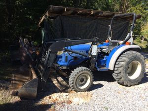 Farm trac 30 hp... low miles!!!(also have bush hog and boom)
