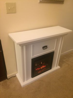 White fireplace/TV stand