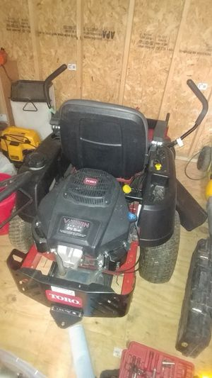 """Is a 42"""" lawn mower in a excellent condition, with only 32 hours used. Great for a big yard. If you are intrested. I am asking $2,100. please call 24"""