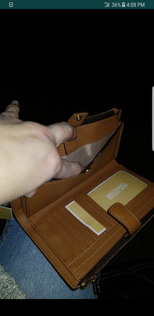 MKS WALLET. SUPER NICE .ALOT ROOM FOR CELLPHONE AND CARDS AND MONEY.