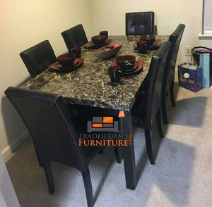 Brand new dining table and 6 leather chairs.