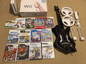 Nintendo Wii with games, guitar and one controller