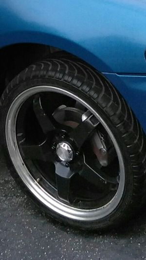 Rims with center caps and tires