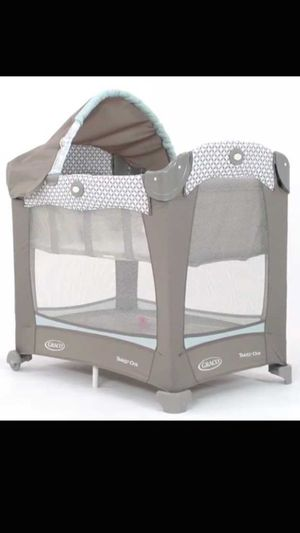 Grace travel lite crib with stages
