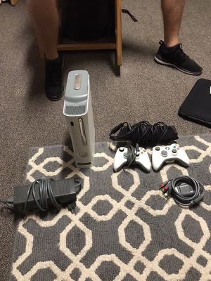 Xbox 360 with Kinect, 15 games, and 2 controllers