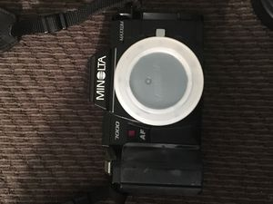 Two Minolta Maxxum cameras with additional lenses. One lens retails for $356.00 . Lots of filters and tripod. Comes with Leather Carrying case.