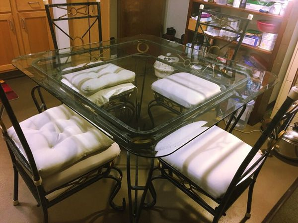 Glass top iron dining table with 4 matching chairs for Furniture federal way