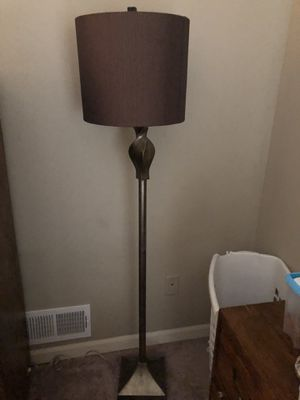 Floor lamp with shade.