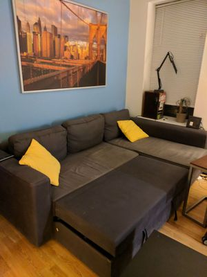 Sofa bed + 2 yellow cushions