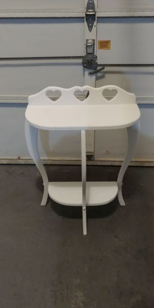 White entryway table with hearts.