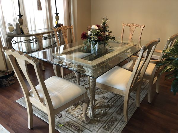 Beige Glass Dining Table With Six Chairs And Side