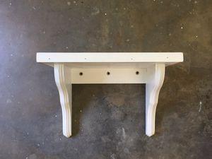 White wooden hanging shelf