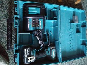 Makita 1/4 inch impact with 3.0 battery and charger and case asking 100 dollars firm