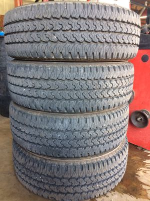 Four LIKE NEW!! 245-70-R17 all terrain tires