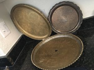 Three brass and silver serving trys