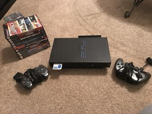 PS2 + 2 CONTROLLER + GAMES...... FIRM PRICE