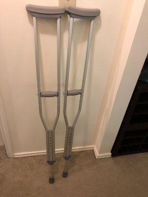 Adjustable metal crutches