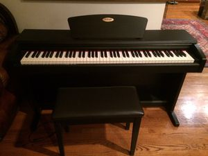 Suzuki digital piano and piano chair