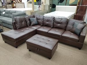 Free local delivery Brand new in box espresso color bonded leather sectional with free storage ottoman