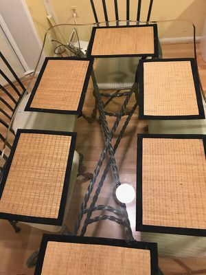 Dining table for six. Rod iron with six chairs excellent condition