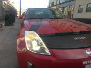 I need broken headlights for Nissan 350Z 2005