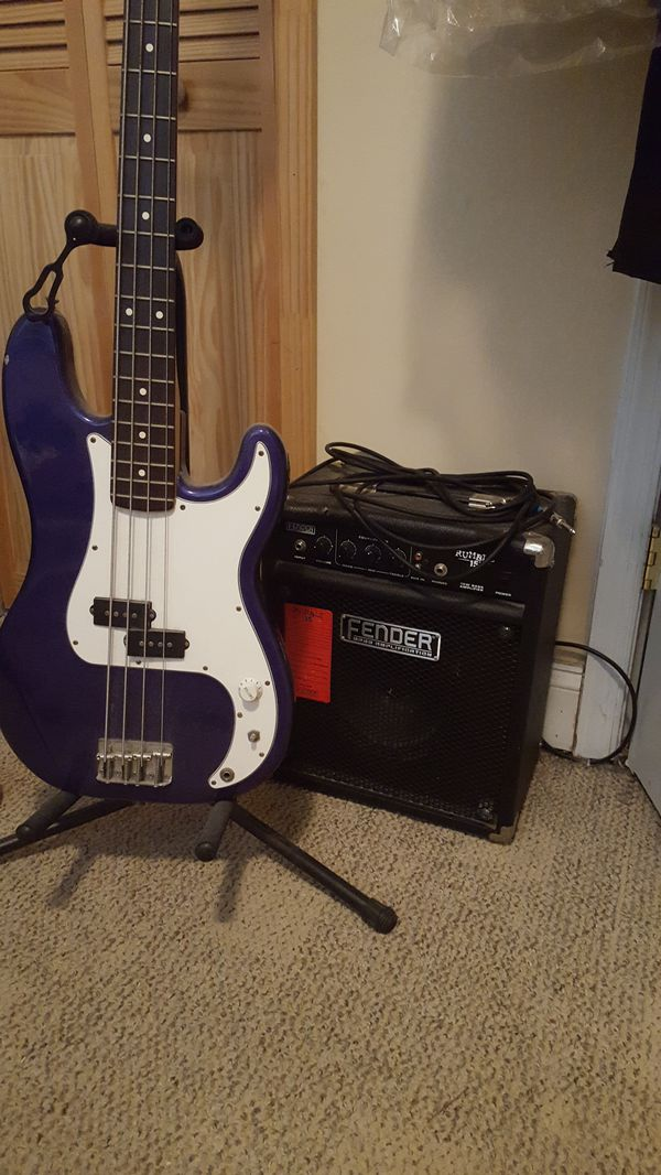 Fender bass guitar, amp, cord, and stand