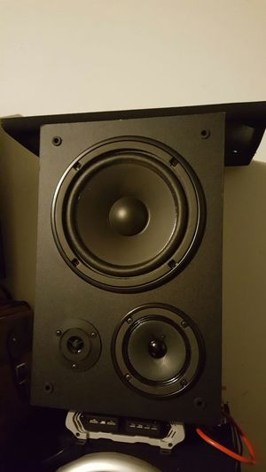 A set of seven Yamaha speakers to subwoofers for bookshelf and one Center speaker
