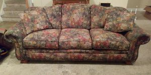 Floral couch with matching pillows