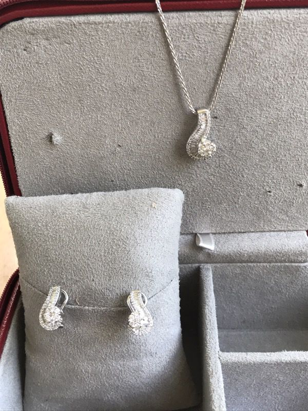 14kt white gold earrings and matching necklace diamonds and baguets