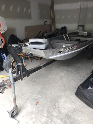 14' jhon boat with trailer fresh battery and 30 thrust trolling motor with title