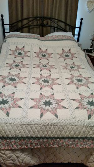 Cream, green and pink quilt