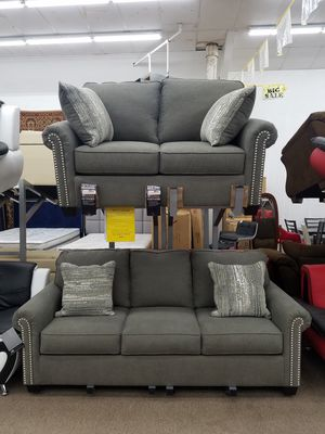 Brand new Factory Direct charcoal color polyester material sofa and loveseat with accent pillows by Ashley Furniture