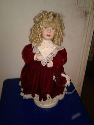 Porcelain animated Christmas doll